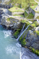 looking cliff tops waterfalls castle beach tintagel cornwall. uk coastline coastal environmental camelot king arthur round table west country tristan isolt mark uther pendragon merlin magician cornwall cornish england english great britain united kingdom british
