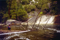 photographer stands fallen tree merced river vernal nevada falls. yosemite np. california american yankee travel john muir np national park cloud mist californian usa united states america