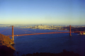 sunset golden gate bridge san francisco background oakland far distance. california american yankee travel sf bay marin peninsula county headlands alcatraz fort point franciscan californian usa united states america