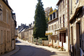 main street village corrèze limousin. french buildings european travel rural pastoral rolling hills correze monedieres granite limousin france la francia frankreich europe