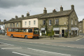 pennine bus stopped gargrave teashop yorkshire dales rural britain countryside rustic pastoral environmental uk transport public single decker sweet england english great united kingdom british