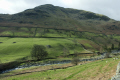 fell hills glenridding beck foreground. green grass sheep stone walls british lakes countryside rural environmental uk village lakeside lakeland walking cumbria cumbrian england english great britain united kingdom