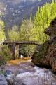 old wooden bridge spanning dourdou gorge near conques france french landscapes european travel aveyron midi-pyrenees midi pyrenees midipyrenees pont river la francia frankreich europe