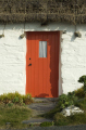 traditional manx thatched cottage red door houses british housing homes dwellings abode architecture architectural buildings uk iom small doorway rural isle man england english great britain united kingdom