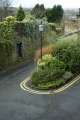 bend small road lampost double yellow lines. uk towns environmental sharp hill brick ivy lancaster lancashire lancs england english great britain united kingdom british