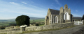 st lukes chapel east baldwin isle man. yew tree gravestones distant hills uk churches worship religion christian british architecture architectural buildings grave churchyard panorama gate man manx england english great britain united kingdom