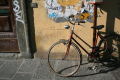 old bicycle leaning wall florence italy bicycles cycling cyclists bikes transport transportation uk firenze florentine italien italia italie europe european italian