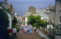 main street clovelly devon looking bideford bay. british seaside coastal resorts leisure uk ilfracombe hartland point barnstaple touristy busy throng trippers pretty picturesque devonian england english great britain united kingdom