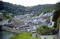 harbour polperro south coast cornwall. harbor uk coastline coastal environmental fishing boat village port quayside anchorage haven cornwall cornish england english great britain united kingdom british