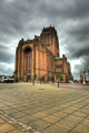 anglican cathedral city liverpool. architecture. brick built overlooking city. hdi shot. uk cathedrals worship religion christian british architecture architectural buildings church cofe scouse dark clouds merseyside england english great britain united kingdom