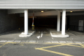 exit car park multi storey carpark. showing barrier way sign uk shopping centres retailers trade centers commercial buildings british architecture architectural shops parking road spiral essex england english great britain united kingdom