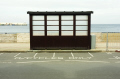 seaside shelter peel isle man motorcycle bay. british coastal resorts leisure uk sea beach rain road wooden manx iom england english great britain united kingdom