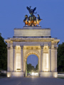 wellington arch hyde park corner london dusk floodlit. uk monuments british architecture architectural buildings bronze capital chariot city evening headlights holiday island landmarks monument night lane piccadilly statue stock tourism tourist spot travel twilight cockney england english great britain united kingdom