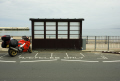 motorcycle parked bay shelter peel beach isle man british motorcycles motorbikes transport transportation uk bike sea road manx tt iom england english great britain united kingdom