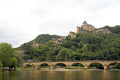 chateau bridge castelnaud-la-chapelle castelnaud la chapelle castelnaudlachapelle overlooking river dordogne. french châteaus european travel pont mediaeval medaeval yellow limestone cliffs perigord noir dordogne aquitaine france la francia frankreich europe