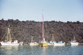 boats anchored volcanic island nea kameni near santorini greece volcanoes geology geological science misc. aegean sea greek cyclades atlantis minoan caldera volcano pumice basalt lava sailing fishing caique europe european