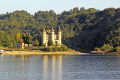 chateau val limousin france. french châteaus european travel correze glacial trees wooded forest woodland reservoir dam barrage lake boating france la francia frankreich europe