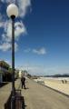 beach promenade cromer norfolk british beaches coastal coastline shoreline uk environmental seaside people walking sun windbreaks england english great britain united kingdom