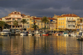 sanary harbour lit setting sun. provence cote azur riviera mediterranean south french european travel var france bateau provencale church eglise saint nazaire st evening twilight sunset provence-alpes-côte provence alpes côte provencealpescôte la francia frankreich europe