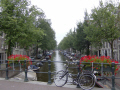 bike resting bridge amsterdam dutch netherlands european travel bikes canal holland la hollande holanda olanda europe