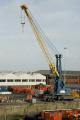 large mobile dockside crane heysham harbour near morecombe lancashire docks uk coastline coastal environmental dock boat loading tall lancs england english great britain united kingdom british