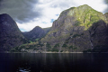 aurlandfjorden norway lowering skies. taken ferry flåm gudvangen sognefjord. wilderness natural history nature misc. showery cloudy flam nutshell sognefjord rail train journey travel norwegian norge kongeriket europe european norwegan