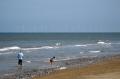 beach winterton norfolk showing offshore windfarm. british beaches coastal coastline shoreline uk environmental paddling pebbly environment power renewable sustainable energy yarmouth east anglia england english great britain united kingdom