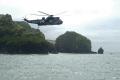 helicopter air sea rescue chopper arrives rnli coastguard lifeboat uk emergency services lizard cornwall cornish england english angleterre inghilterra inglaterra united kingdom british