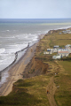 cliff erosion close caravan park cromer norfolk uk coastline coastal environmental collapse beach seaside caravans danger united kingdom british