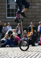 clown street performers buskers arts misc. performer unicycle united kingdom british