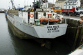 ben maye cargo boat unloading cement ramsey harbour harbor uk coastline coastal environmental ship merchant local coaster marine united kingdom british