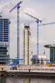 construction work new development salford quays building uk business commerce cranes architecture modern manchester england english angleterre inghilterra inglaterra united kingdom british