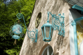decorative ironwork portmeirion british architecture architectural buildings wrought iron signs shop north wales lamp gwynedd welsh país gales united kingdom