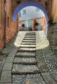 archway cobbled steps portmeirion village british architecture architectural buildings pastel colours gwynedd wales welsh país gales united kingdom
