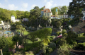 portmeirion gardens general view people british architecture architectural buildings balcony wrought iron pastel colours village trees gwynedd wales welsh país gales united kingdom