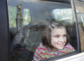 young girl smiling looking car window reflection buckingham palace it. london royalty queen tourism famous sights capital england english cities tourist sight-seeing sight seeing sightseeing enjoy landmark residence cockney angleterre inghilterra inglaterra united kingdom british