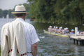 spectator steward wearing panama hat jacket club colours watching race royal henley regatta thames river rowing rowers sport sporting celebrities celebrity fame famous star boats row referee summer event competition henley-on-thames henley on thames henleyonthames oxfordshire home counties england english angleterre inghilterra inglaterra united kingdom british