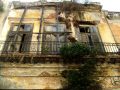 colonial building havana cuba walls abstracts tatty worn rotten wood balcony washing line mediterranean paint window caribbean cuban
