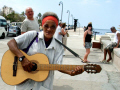 busker havana cuba street performers buskers arts bay harbour malecon castillo san salvador la punta fortress old lady caribbean cuban