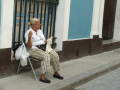 old lady knitting havana cuba elderly women aged senior woman female females feminine womanlike womanly womanish effeminate ladylike caribbean cuban