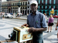 man old pin hole box camera outside capitolio havana cuba multicultural ethnic photographic colonial tourist attraction photograph polaroid caribbean cuban