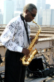 saxaphonist busker brooklyn bridge new york american yankee music saxaphone player musician big apple united states