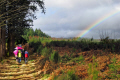 group walkers monedieres region southern limousin recent shower. friends friendship buddies pals groups forest monédières winter valley hikers hiking ramblers rambling walking promenade randonnee rain squall rainbow correze france la francia frankreich french