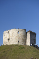 clifford tower fortress castle mound york blue sky. historic building medieval tourist attraction looking city yorkshire british castles architecture architectural buildings tourism sight seeing england english angleterre inghilterra inglaterra united kingdom