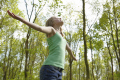 young girl standing wood forest spring time arms outstretched taking deep breath fresh air enjoying environment emotions emotional mental states behaviour bahavior feelings faces visage children teenagers trees high wycombe buckinghamshire bucks england english angleterre inghilterra inglaterra united kingdom british
