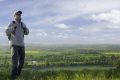 man walking landscape hike rucksack looking country fields buckinghamshire chilterns physical exercise athletic aerobic anaerobic health fitness environment high wycombe bucks england english angleterre inghilterra inglaterra united kingdom british