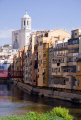 girona spain apartments businesses lining river onyar. distance cathedral catalunya catalonia spanish espana european església church tower religious catholic espagne españa catedral costa brava spanien la spagna