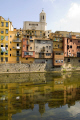 girona spain apartments businesses lining river onyar. distance cathedral catalunya catalonia spanish espana european església espagne españa bridge reflection church tower religious catholic catedral costa brava spanien la spagna