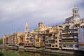 girona spain apartments businesses lining river onyar. distance collegiate church sant feliu cathedral catalunya catalonia spanish espana european església tower religious catholic espagne españa catedral bridge costa brava spanien la spagna
