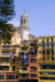 girona spain apartments businesses lining river onyar. distance cathedral catalunya catalonia spanish espana european església church tower religious catholic espagne españa catedral artistic photoshop digital arts costa brava spanien la spagna